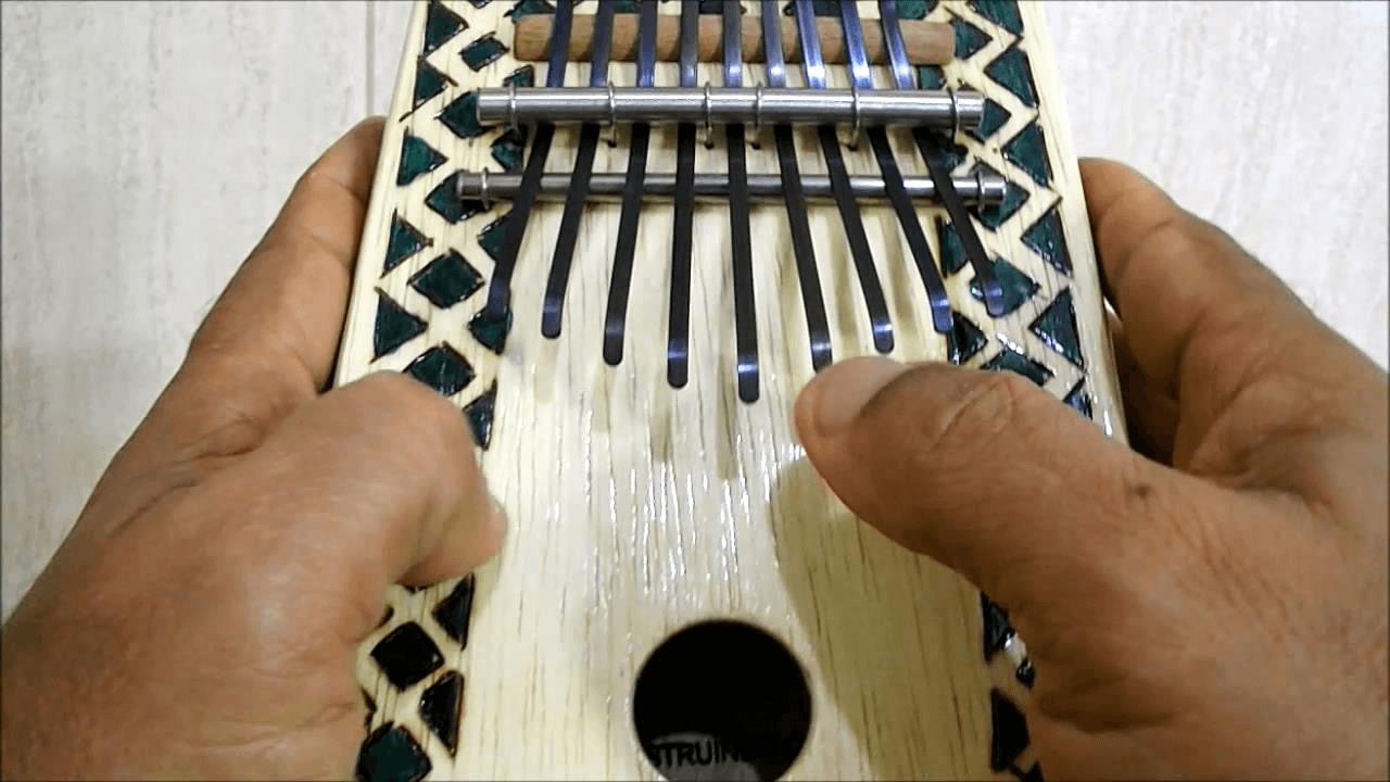 Kalimba em madeira decorada